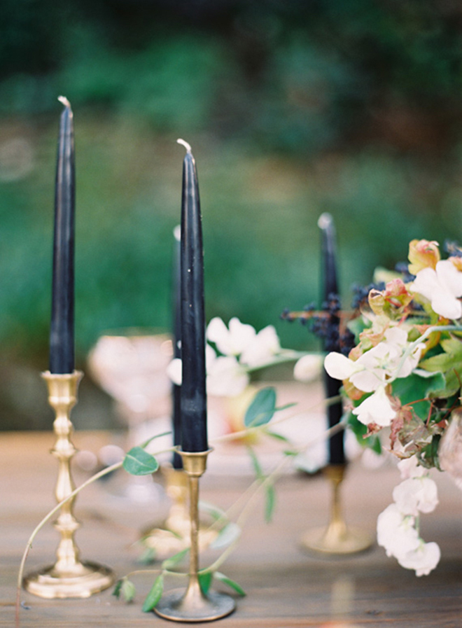 Gorgeous navy blue taper candles in gold holders!