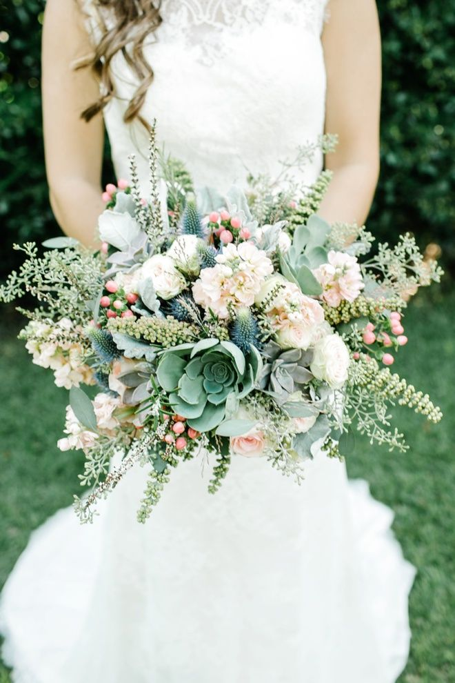 Fabulous, large green, peach and blue wedding bouquet with succulents.