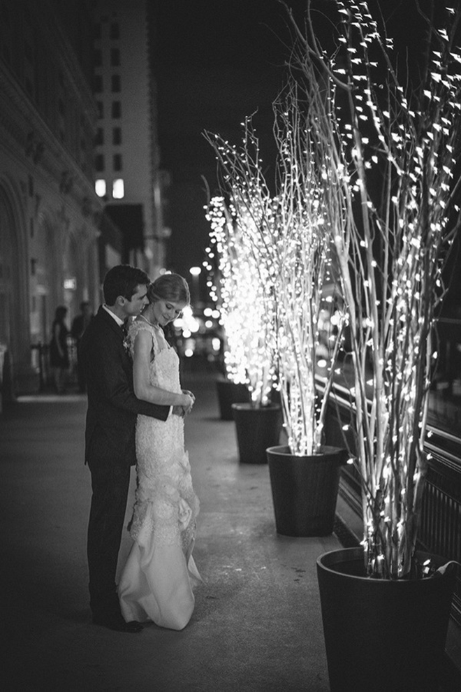 Pose for photos next to lit trees for a romantic look
