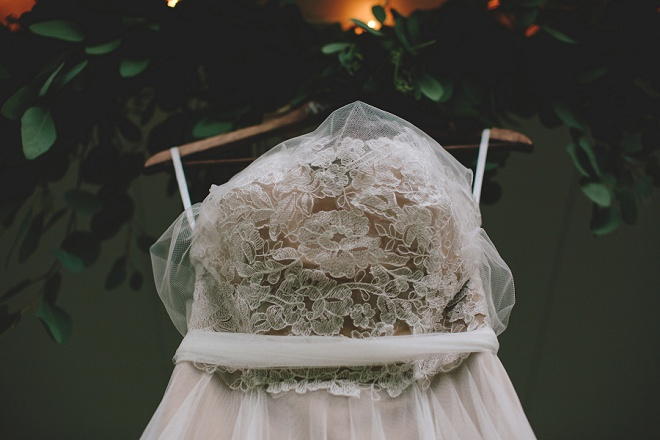 We're dying over this gorgeous wedding dress photo with dreamy eucalyptus!