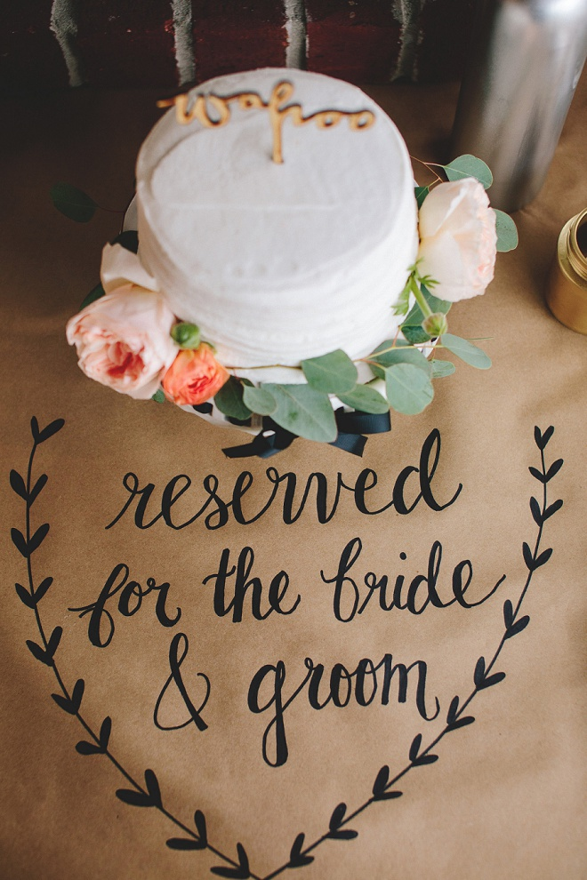 We're swooning over this gorgeous DIY kraft paper tablecloth for the dessert table and darling cut cake with wooden cake topper!