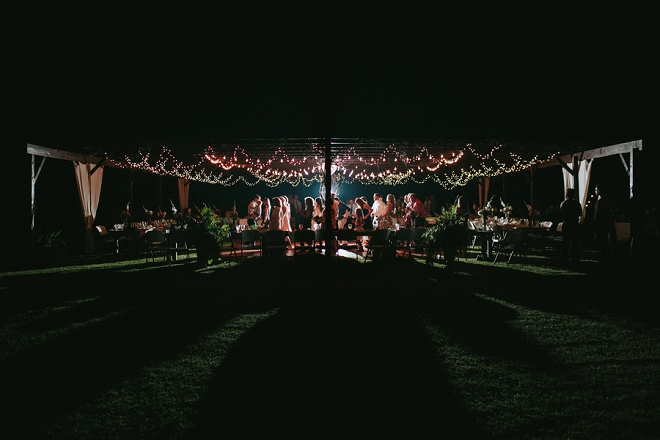 We're swooning over this twinkle lit boho backyard wedding!