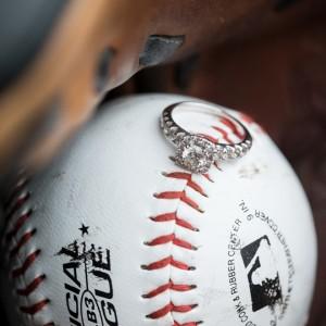 Beautiful wedding ring shot on top of a baseball - perfect idea for baseball fans!