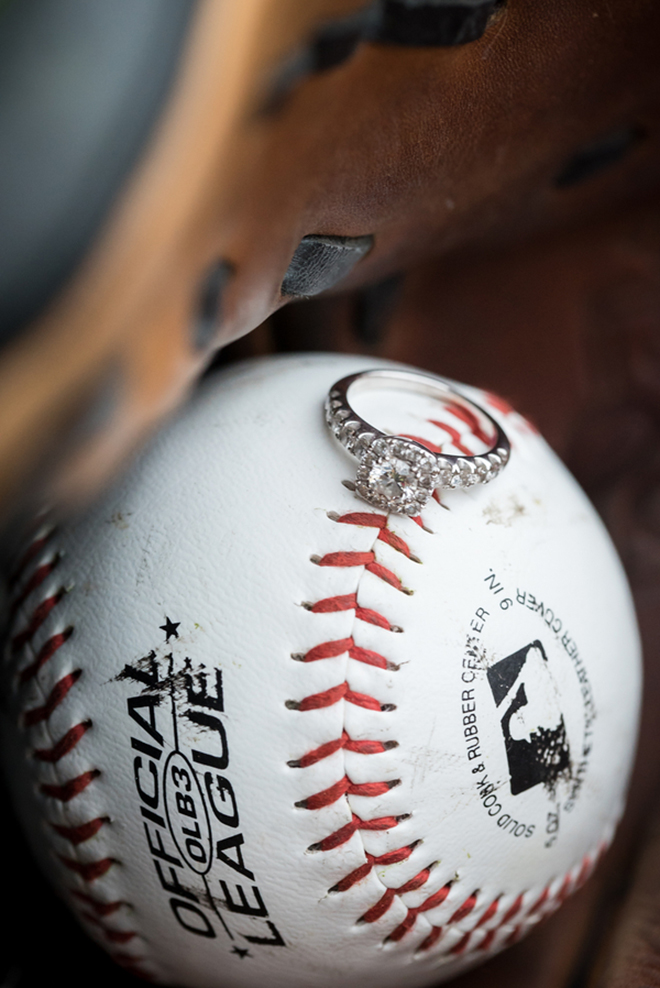 Beautiful wedding ring shot on top of a baseball - perfect idea for baseball fans!