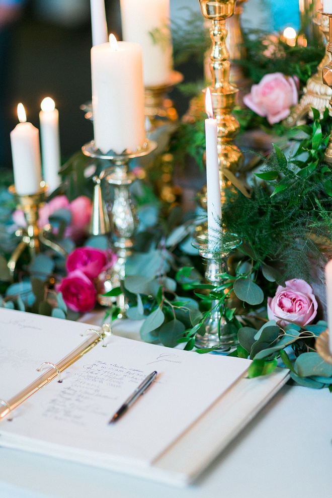 We're loving all of the greenery detail at the guest book table at this boho wedding!