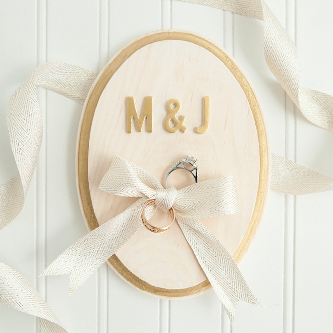 Learn how to make this cute painted ring bearer plaque for Diy ring bearer