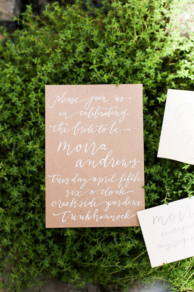 We're loving this gorgeous white on kraft organic invite to this bridal shower!