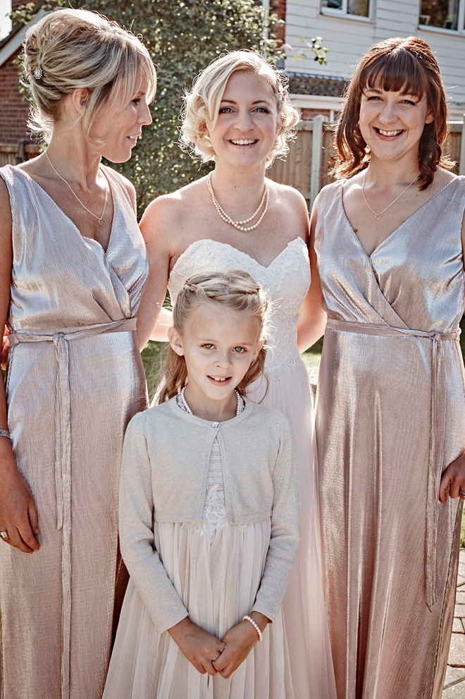 Loving the Bridesmaid's metallic dresses at this fun UK wedding!