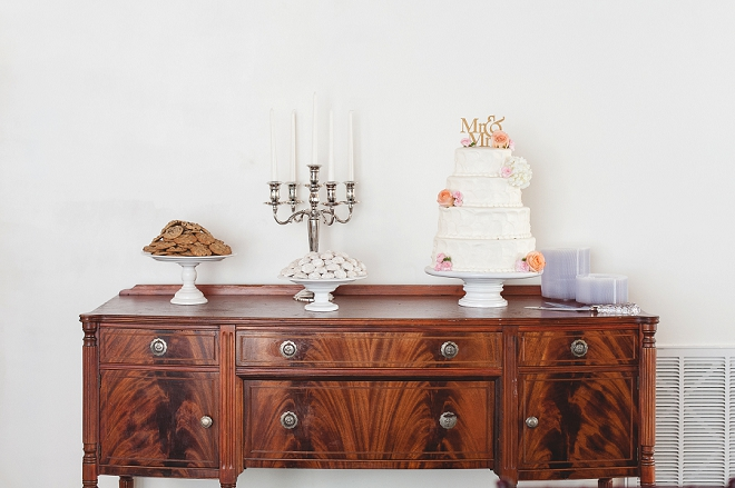 Gorgeous wedding cake and simple cookie dessert table!