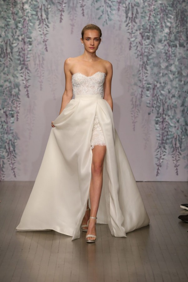 You can walk down the aisle with a beautiful train, then show some leg at the party with this Monique Lhuillier gown