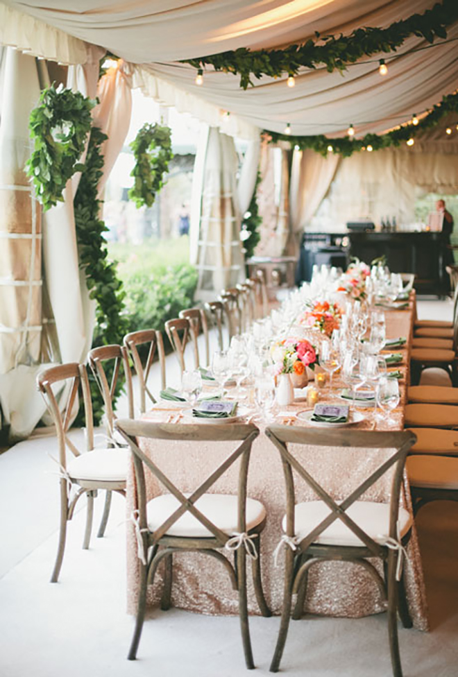 greenery garlands add a chic and natural element to a wedding tent