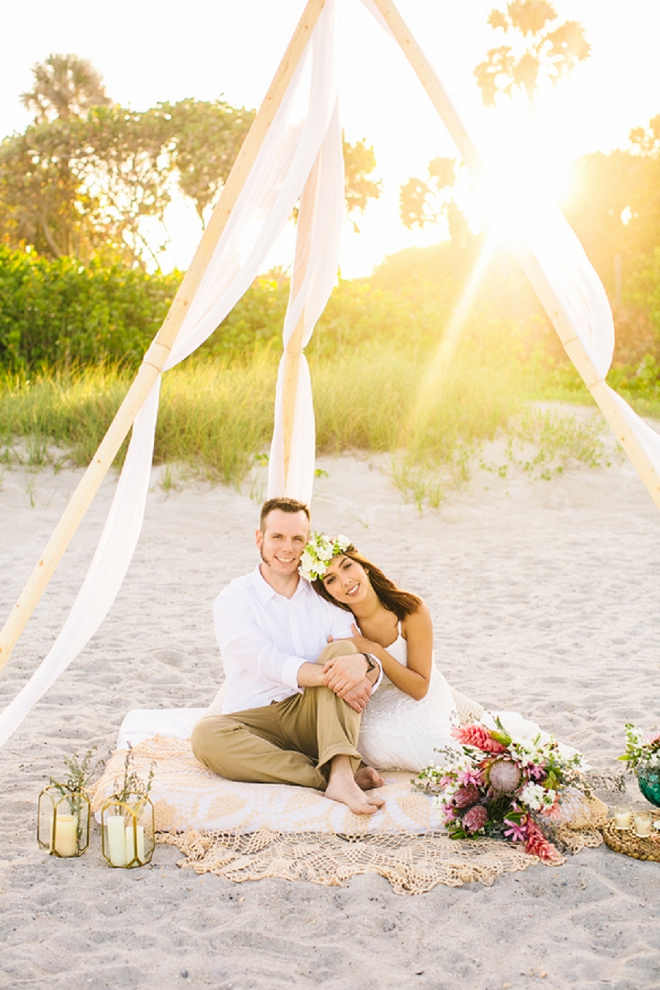 Swooning over this gorgeous draped tee pee on the beach!