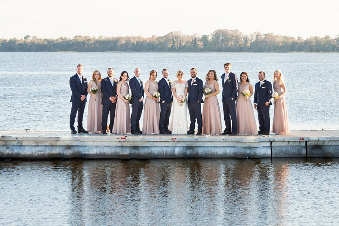 Fun shot of the Bride and Groom and their wedding party on the lake!