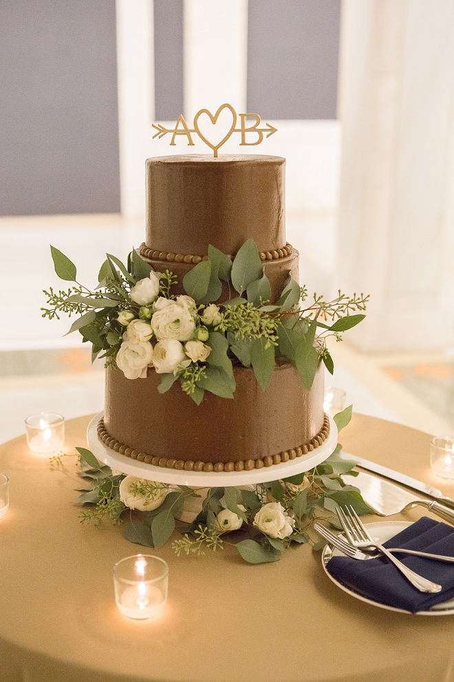 Loving this gorgeous simple chocolate cake with greenery and gold monogrammed cake topper!