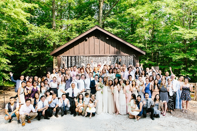 What a FUN photo of the entire wedding after the ceremony?! Love it!