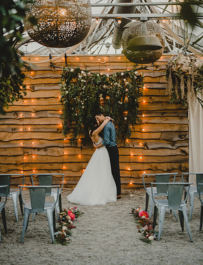 We love this romantic rustic garden ceremony backdrop!