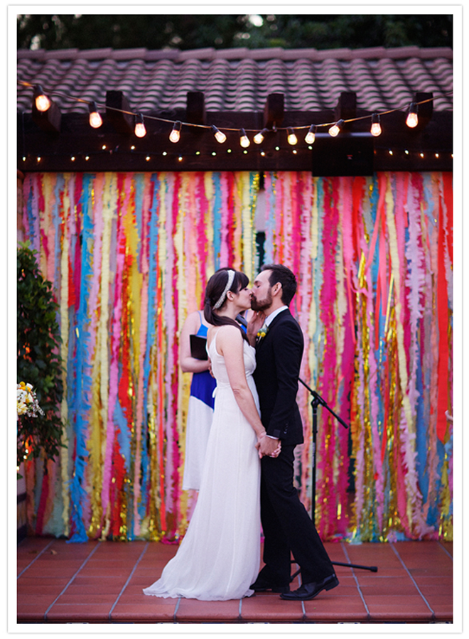 How stunning is this DIY bright and colorful streamer ceremony background?! Love!