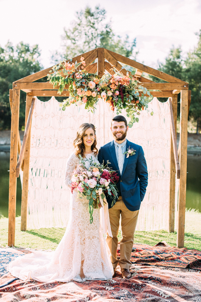 Loving this boho floral inspired treehouse wedding ceremony backdrop!