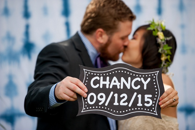 Loving the photo booth and hand dyed backdrop at this fun backyard wedding!
