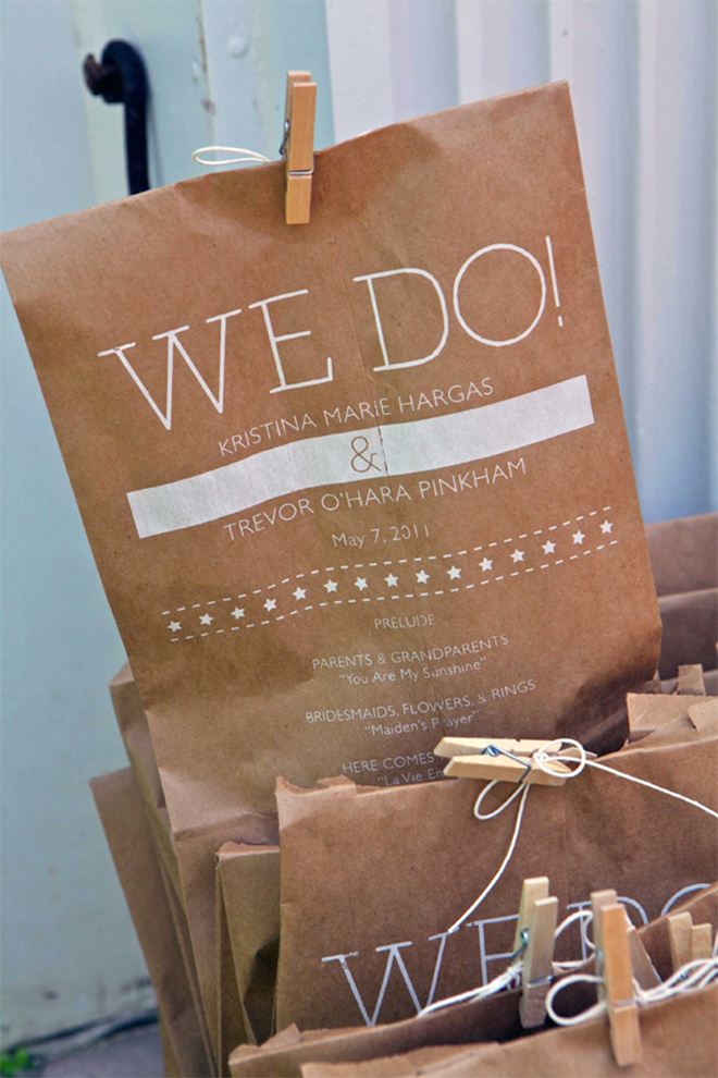 these adorable wedding program pouches have pom poms inside!