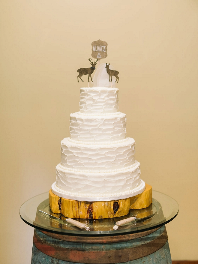We love this couples darling wedding cake and always rustic cake topper!