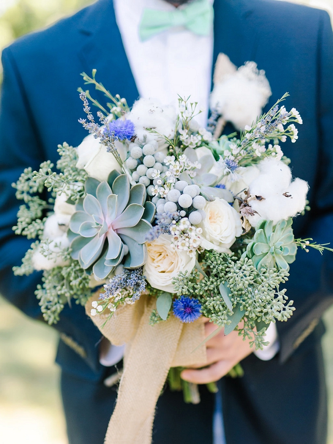 We love this shot of the Groom and his Bride's bouquet!