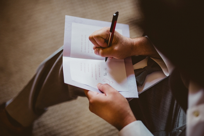 Loving this super sweet snap of the Groom writing his Bride her card!