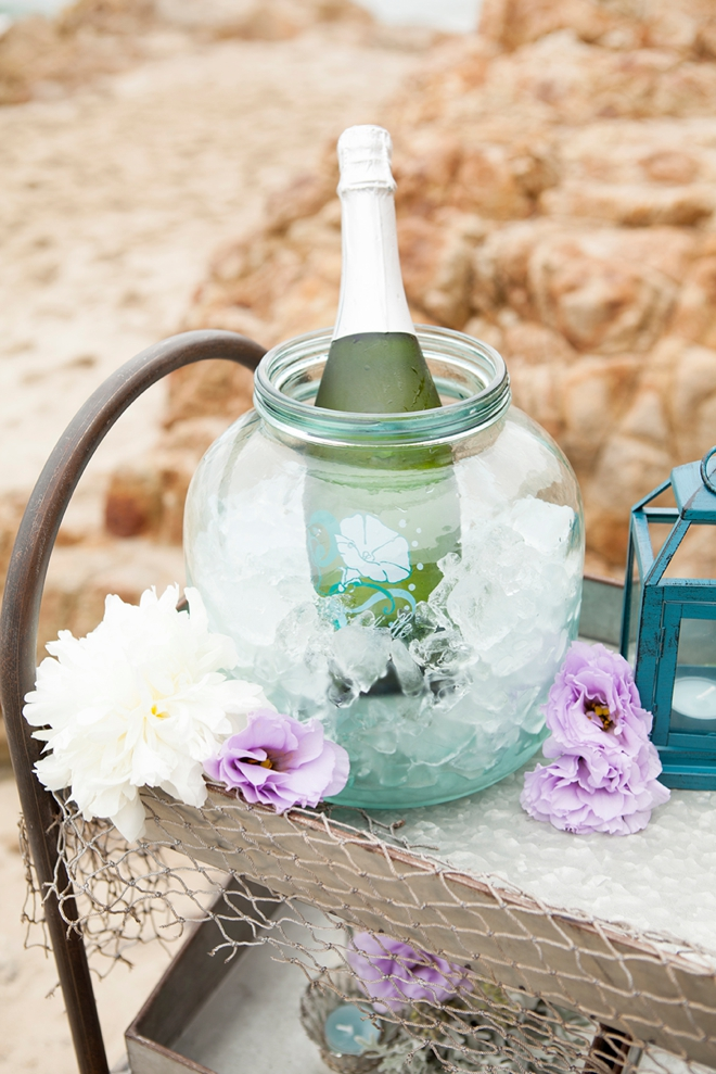 Champagne on ice in a giant glass jar, love this!