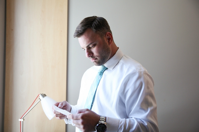 We love this shot of the Groom getting his Brides note before the big day!