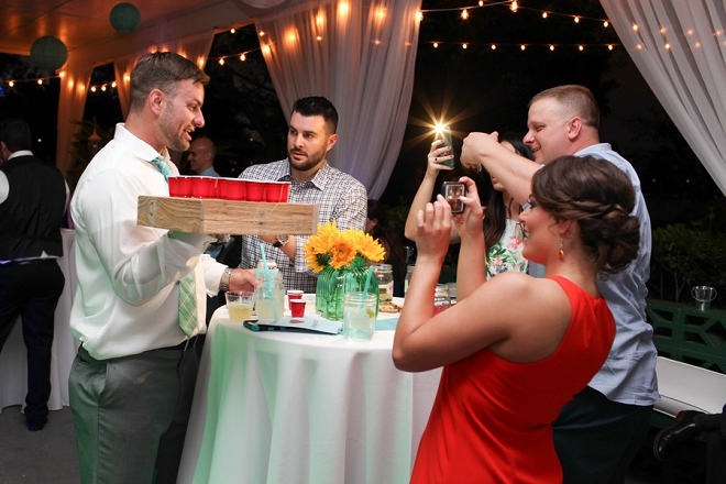 Fun shot of the Groom serving his guests up at the reception!