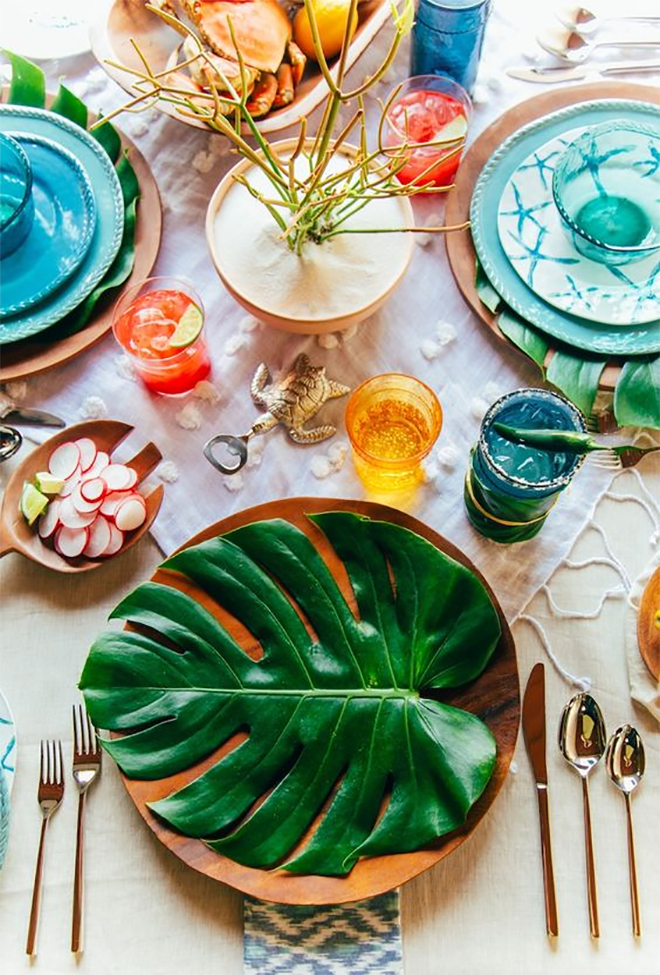 layer the table with leaves and textiles to save on flowers.