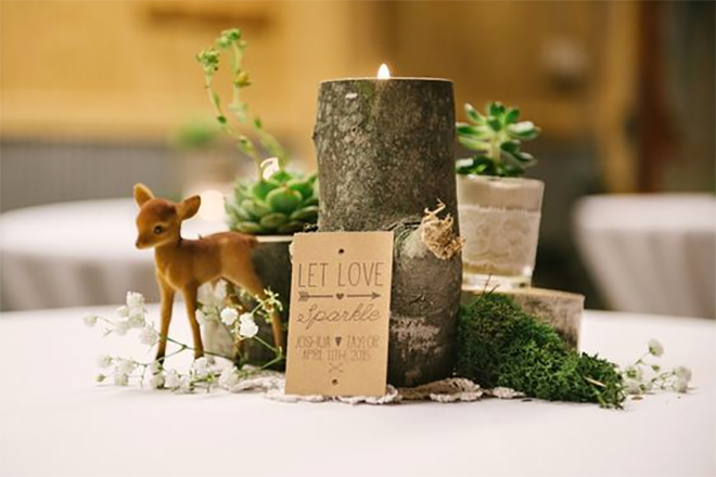 logs with candles and mini forest animals make adorable centerpieces.