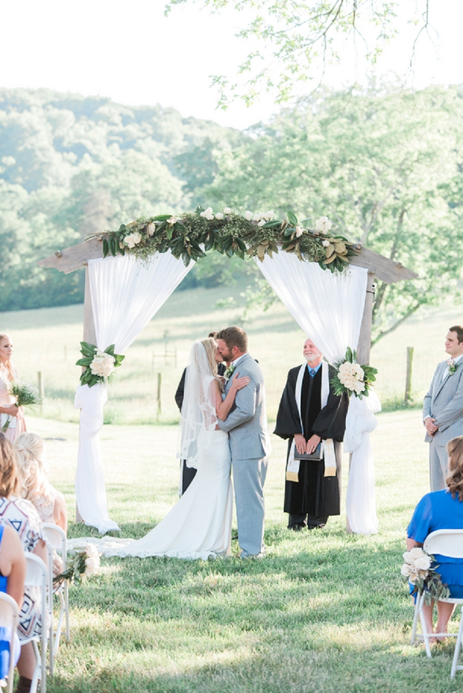 First kiss as Mr. and Mrs at this darling wedding!