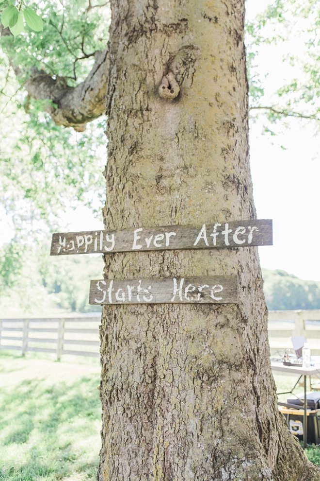 We love this wooden tree sign at this couple's ceremony!