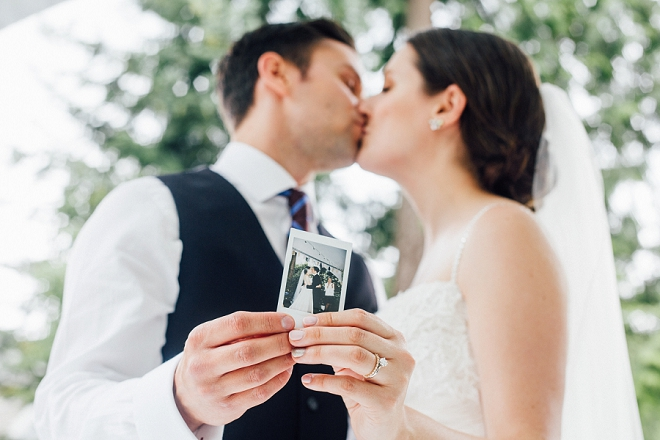 We're in LOVE with this adorable snap of the new Mr. and Mrs. and their Polaroid guest book!