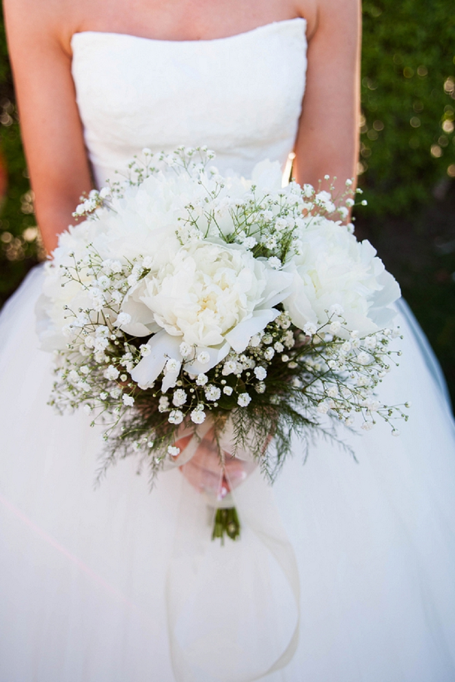 We're loving this shot of the gorgeous Bride and her stunning all white wedding bouquet!
