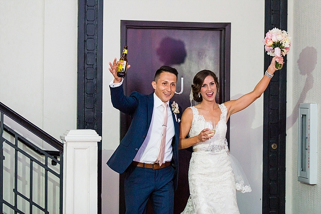 Cute snap of the new Mr. and Mrs. entering their reception!