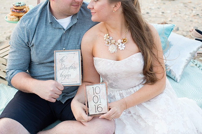 Such a sweet snap of the Mr. and Mrs. and their wedding date sign!