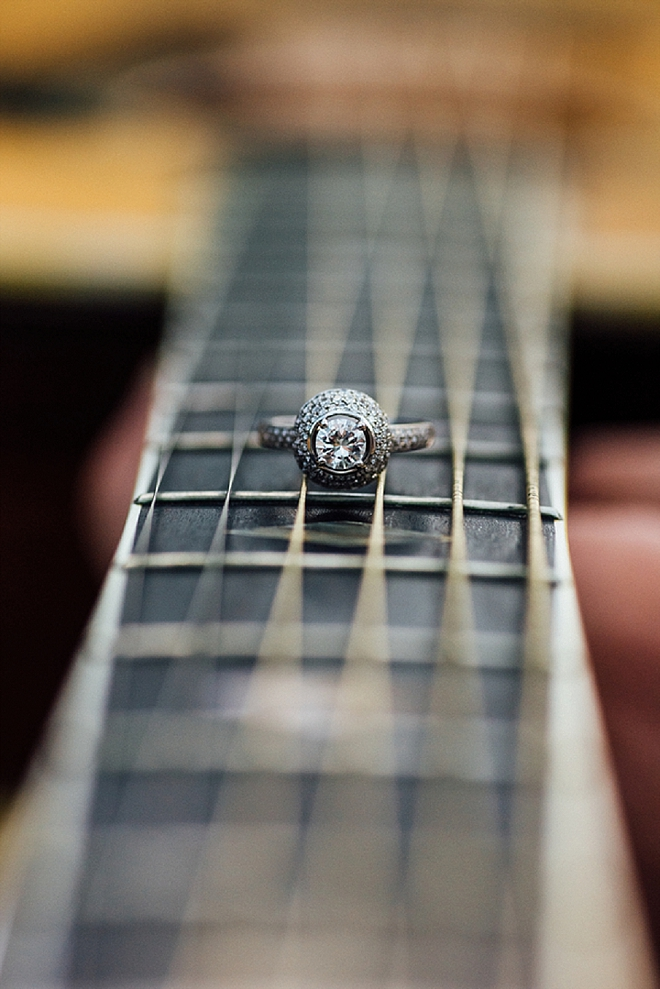 We love this stunning ring shot at this gorgeous lakeside guitar engagement!