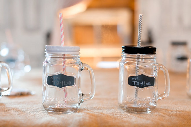 How sweet are these Mr. and Mrs. mason jar cups at this darling reception?! Love!