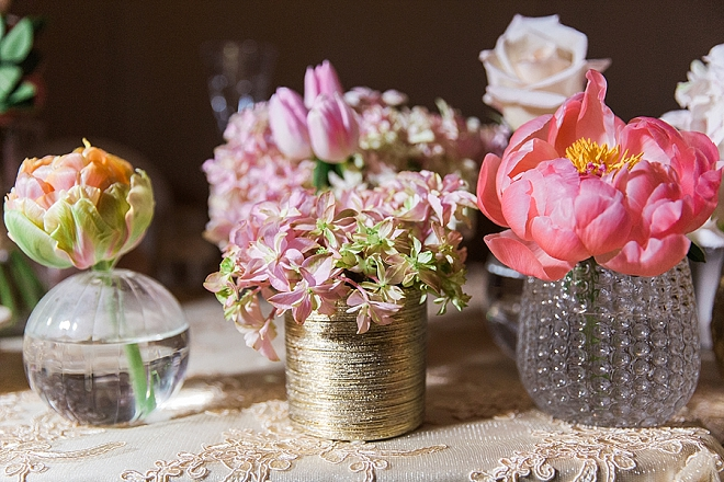 We love these gold floral centerpieces at this couple's stunning wedding!