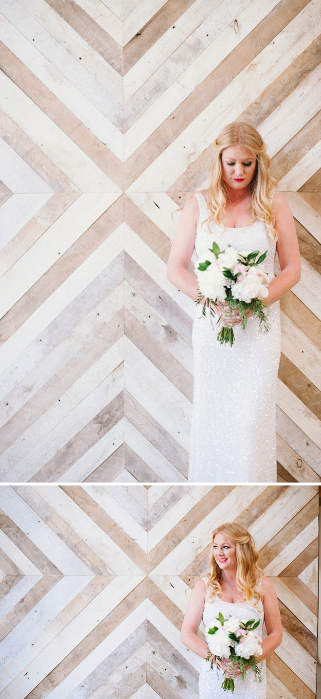 Breathtaking! We love this snap of the Bride and her DIY'd ceremony background!