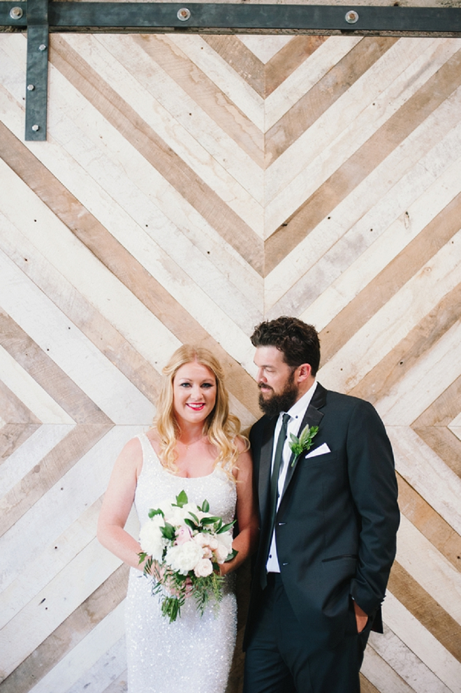 We love this stunning industrial loft wedding and handmade ceremony backdrop!