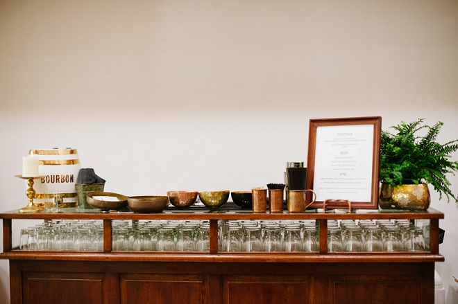 We love this super cute bourbon bar at this loft wedding!