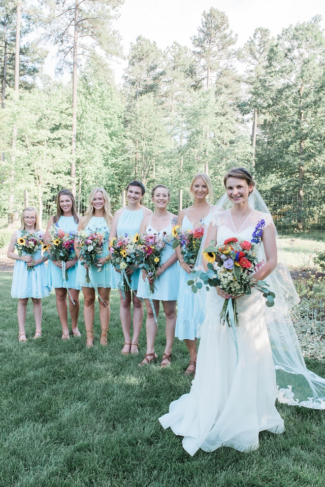 We love this stunning Bride and her turquoise Bridesmaids!