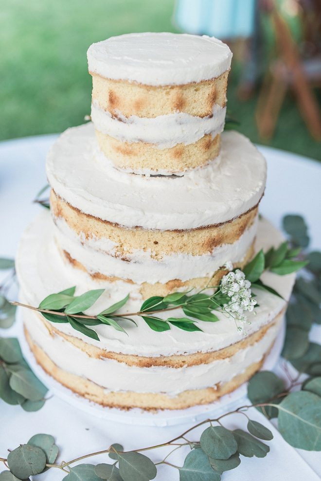 We couldn't love this stunning naked wedding cake with eucalyptus decor any more!