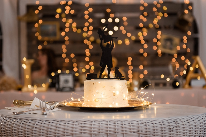 Check out this couple's cute cake topper! How fun!