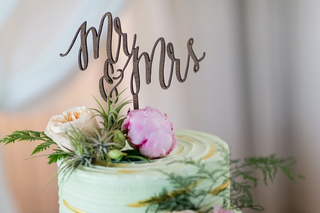 We love this darling Mr and Mrs cake topper on this gorgeous cut cake!