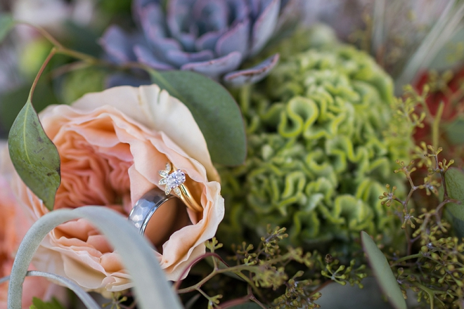 We love this couple's gorgeous florals and ring shot!!