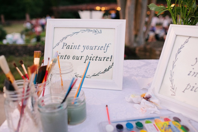 We love this super crafty paint yourself guest book painting! The perfect keepsake!